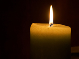 Candle flame white candle burning with darkness surrounding public domain image